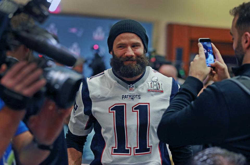 Houston, TX 2-1-17: Patriots wide reciever Julian Edelman flashed a smile as he is the center of some attention at the New England media availability on Wednesday. The New England Patriots held a press availability at their hotel in Houston this afternoon. (Globe Staff Photo/Jim Davis) reporter: various topic: Super Bowl